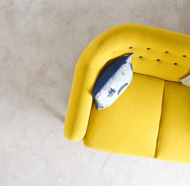 yellow midcentury couch cleaned by chem dry of wake county